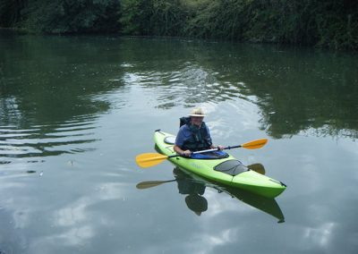 Green kayak with self afloat on the Gloucester ship canal